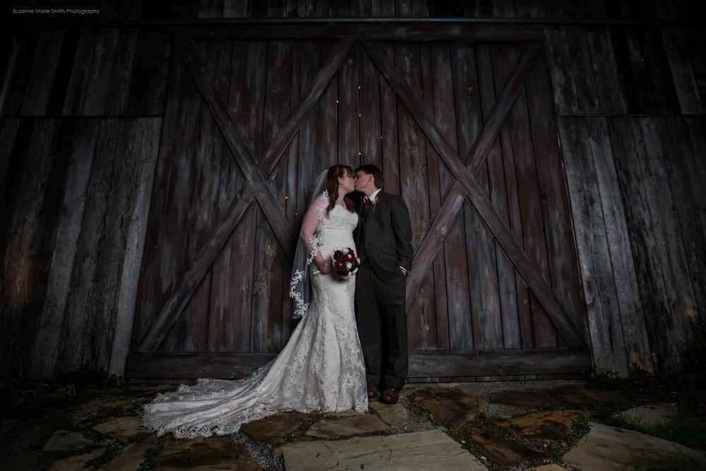 A kiss outside the barn