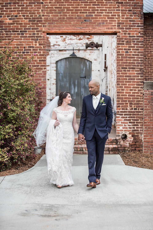 bride and groom walking outside engine room.jpg