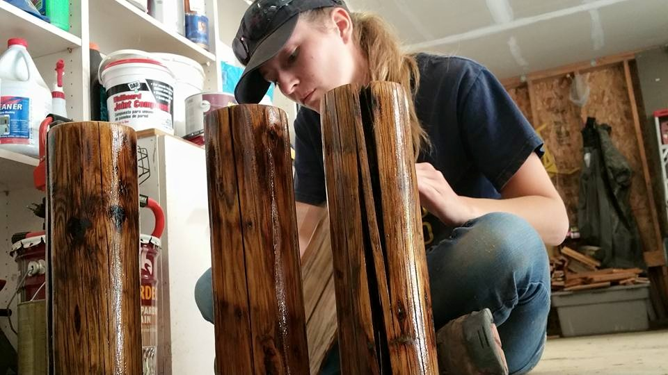 This is me adding a coat of stain to the table legs. These legs are actually salvaged fence posts that we found on the farm!