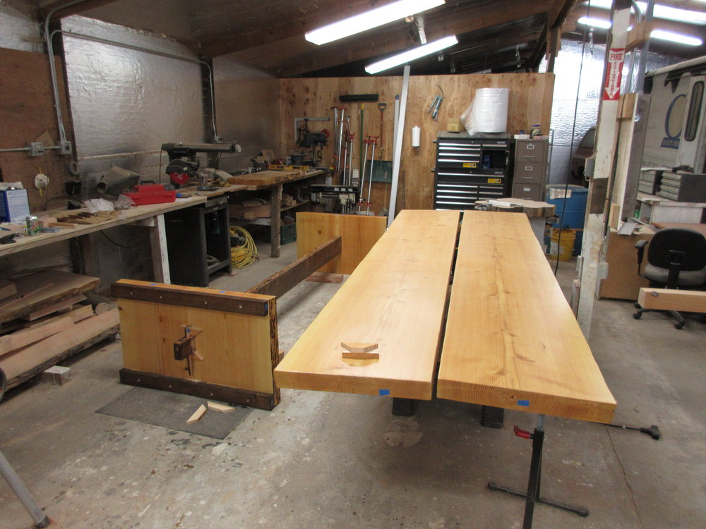 This is the undercarriage and the table slabs sitting side-by-side. Suddenly, our shop seemed a little small...