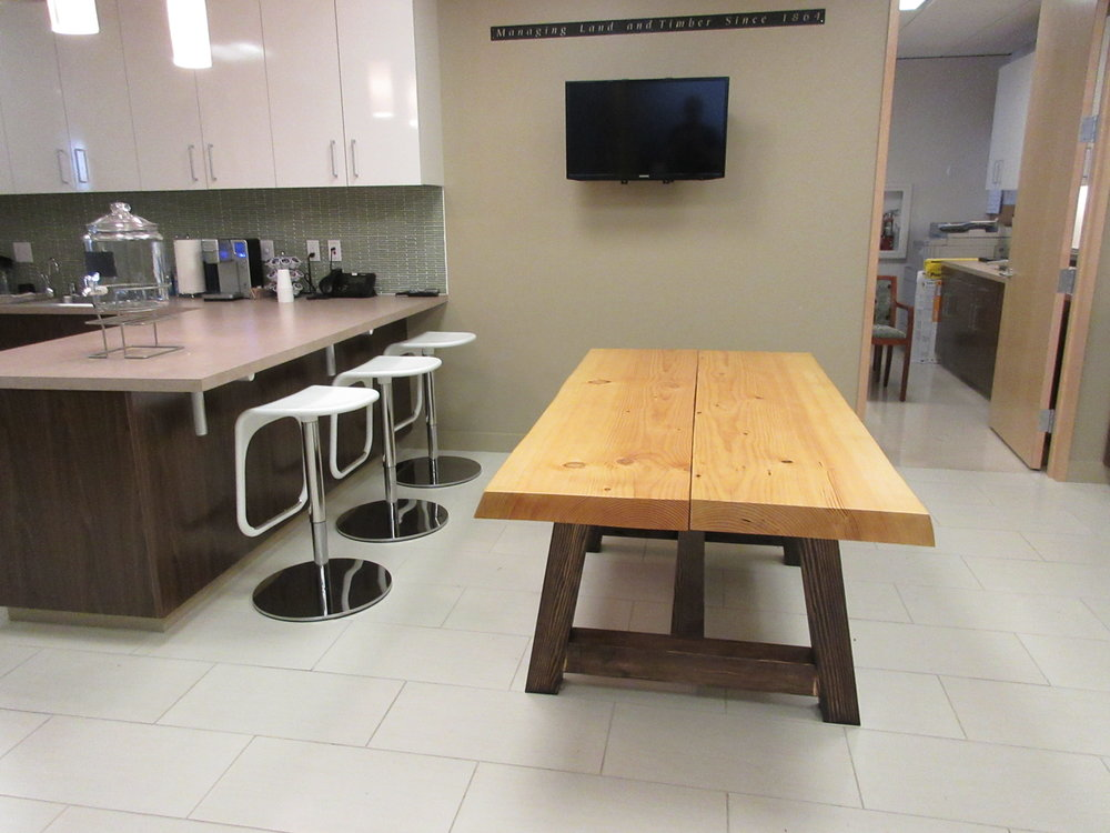 This is the kitchen table we made as well. I love the way the table contrasts with the modern look of the kitchen. These tables now seem so small compared with the conference table!!
