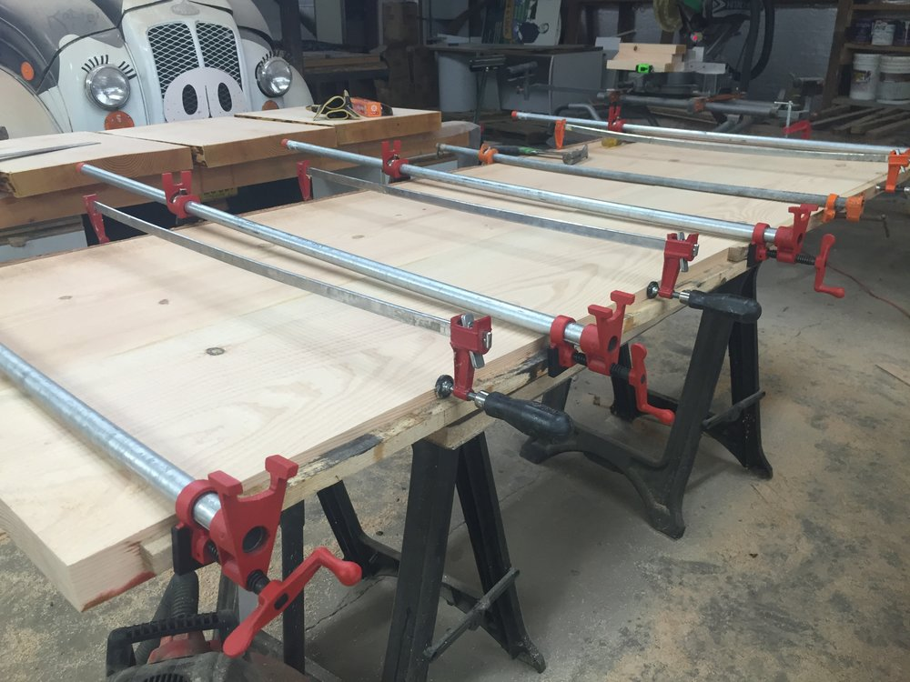 After we joint the slabs, we glued two of them together to get the full width we were going for. We bought some heavy-duty clamps and crossed our fingers that everything would work out right.