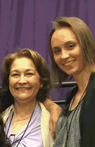 The author (right) meeting Terry O'Neill, president of National Organization for Women.