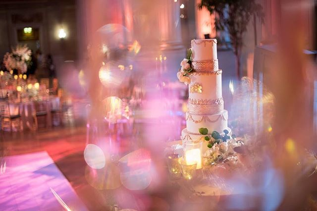 This is what dreams are made of folks! In celebration of #nationalcakeday behold this beautiful @couturecakesbysabrina creation that she made for our clients' Game of Thrones inspired wedding last year at @mellonauditorium_eventemissary | photo: @eliturnerstudios | planning + design: @abeyoutifulfete | florals: @bluevandadesigns | rentals: @dcreventrentals | lighting: @summiteventlighting | dance floor: @fabeventsdc | trees: @twigzstudios . . . . . #weddingcake #flowers #florals #andrewmellonauditorium #washingtondcwedding #summerwedding #stylemepretty #theperfectpalette #dailydoseofcolor #iloveflowers #floraldesign #weddinglighting #gameofthroneswedding #luxewedding #greenery #centerpiece #elegance #simplicity #collaborations #teamwork #collaboration #weddingreception #golddetails #dailydoseofpaper #luxurywedding #swoonworthy #sugarart #cakeartist #sugarflowers