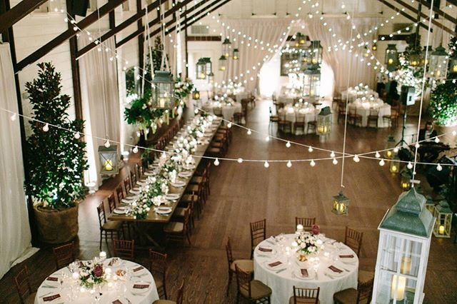 This picture is an excellent example of how lighting can transform aka change the look and feel of a space! So let's take a moment to appreciate this timelessly chic landscape filled with a romantic ambiance created by hanging lots of lanterns and bistro lights, an abundance of candles, soft uplighting, live trees, and a fabulous 24ft floral installation!⠀⠀⠀⠀⠀⠀⠀⠀⠀ .⠀⠀⠀⠀⠀⠀⠀⠀⠀ —⠀⠀⠀⠀⠀⠀⠀⠀⠀ featured on @washingtonianmag and @washingtonianweddings | photo: @emthegem / @emilyscott⠀⠀⠀⠀⠀⠀⠀⠀⠀ venue: @pippinhillfarm | florals: @blueridgefloraldesign | lighting: @blueridgeeventproduction | band: @bachelorboysband | trees: Hot Pots | stationery: @jollyedition⠀⠀⠀⠀⠀⠀⠀⠀⠀ .⠀⠀⠀⠀⠀⠀⠀⠀⠀ —⠀⠀⠀⠀⠀⠀⠀⠀⠀ #imengaged #weddingday #yas #ww #weddingwednesday #simplicity #elegance #film #filmphotography #charlottesvillewedding #pippinhill #pippinhillwedding #luxuryweddings #stylemepretty #flowersofinstagram #swoonworthy #lastdaysoffall #fallwedding #bepdayever #bestdayever #floralanddesign #dailydoseodpaper #luxuryweddings  #floralladder #dcweddingplanner #dcweddingcoordinator #bestoftheday #blackgirlskillingit #bossbabe #wanderlust