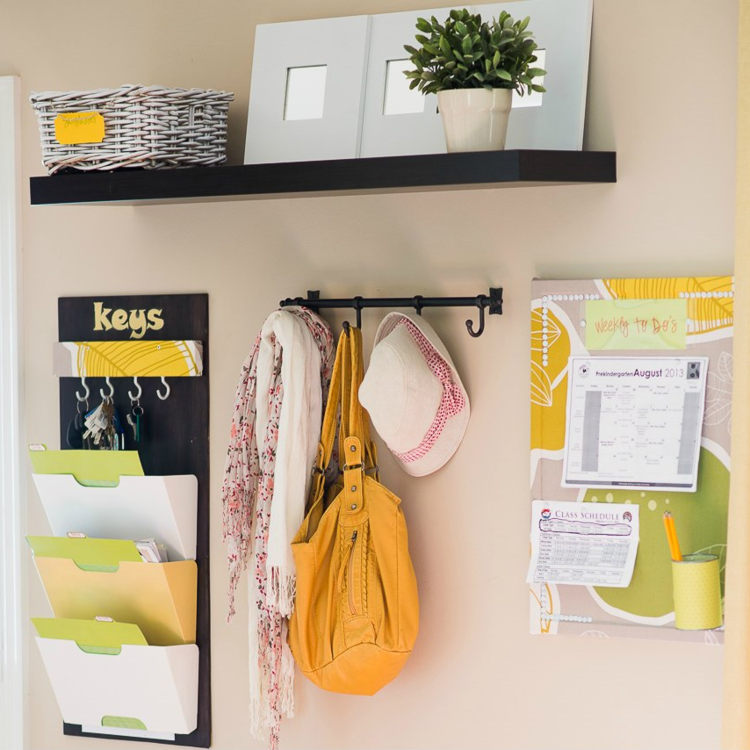 "Create calm at your front door by installing an information station in your entryway. A magazine rack keeps papers from piling up, and small hooks provide an easy-to-find spot for your keys.  Image Credit: Aniko Levai of  ""Place of My Taste"""