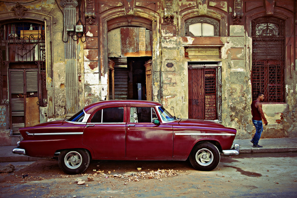 Pristine retro American cars; beautiful historical architecture crumbling under peeling paint