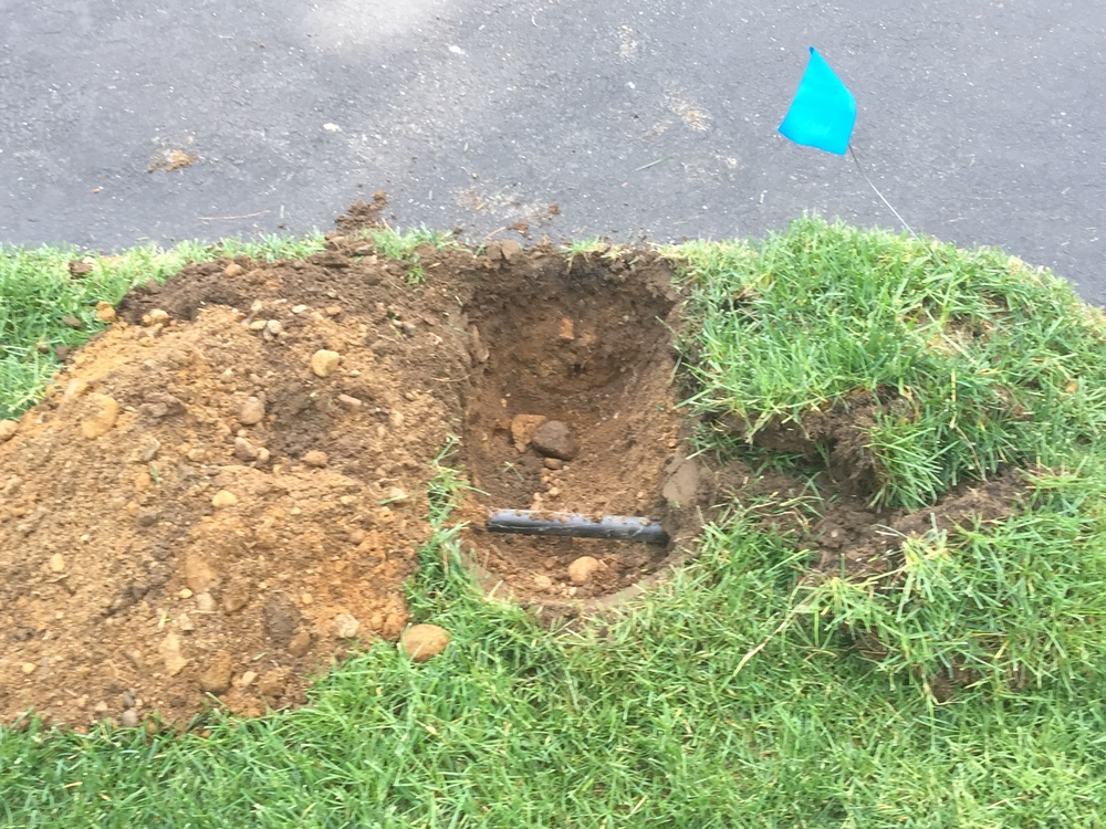 Each sprinkler head requires a hole to be dug to hook up equipment to water source.  Special care is paid while digging, separating existing grass and underlying dirt to ensure efficient installation and more importantly, minimal damage.
