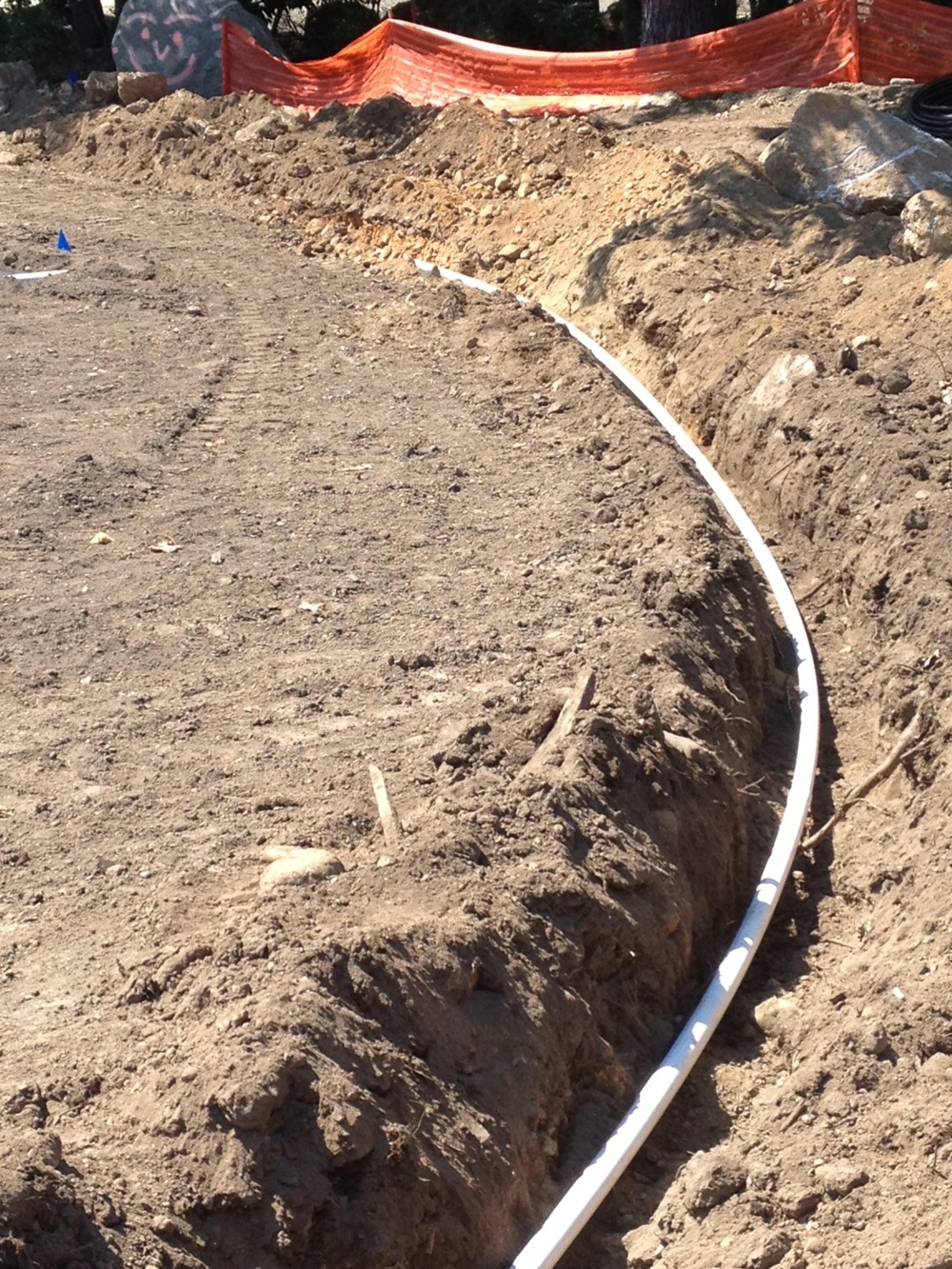 Large scale commercial installs often require the use of PVC piping for main lines in order to provide the necessary volume and pressure rating for the system.  As a result, special equipment must be utilized for trenching, backfilling and other aspects of installation.