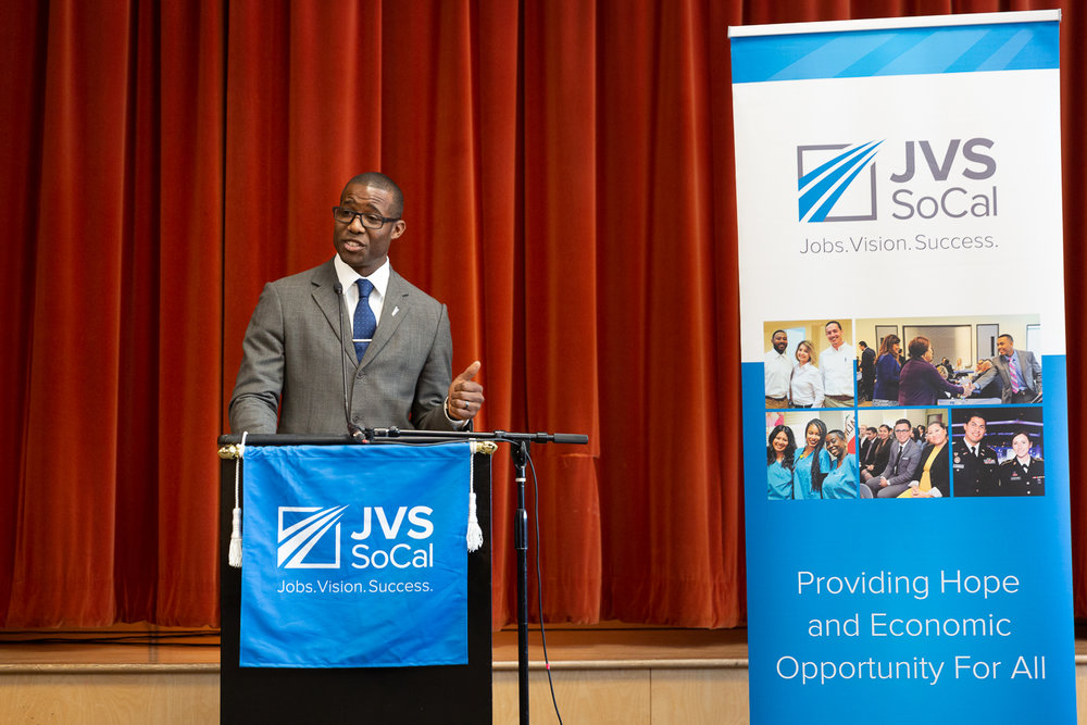 Jerry Walker speaks at the JVS BankWork$ graduation ceremony last April. Photo – Jonathan Barenboim