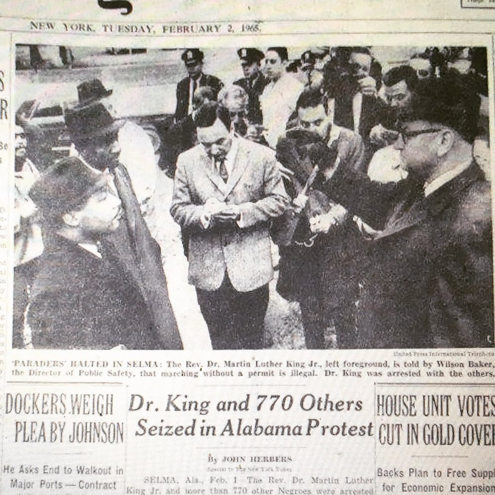 "Here he is on February 1, 1965 on the cover of the  New York Times , at the moment Selma's Public Safety Director, Wilson Baker, arrested King and his followers: ""Each and every one of you is under arrest for parading without a permit.'' Incredibly, in this photo, my father is standing in the exact middle of these two men, a fitting place for a journalist."