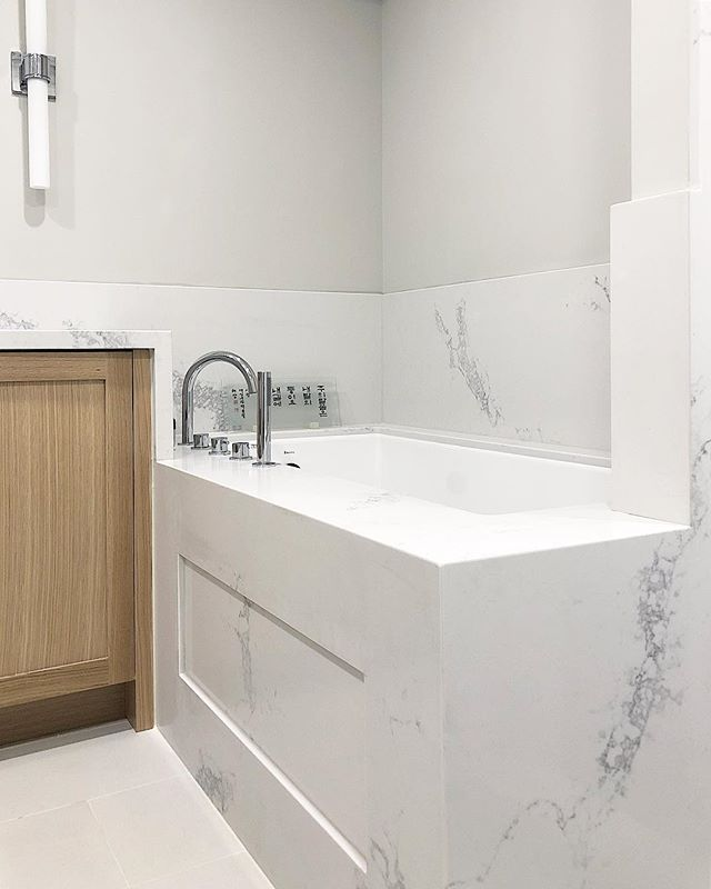 Tub wrapped in quartz with a cleverly designed access-panel.  Material: 5031 Statuario Maximus #caesarstone . . .  #countertop #kitchen #kitchencountertop #vanity #washroom #bathroom #commercial #residential #bars #fireplace #fireplacesurround #tubdeck #marble #granite #quartz #quartzite #design #interiordesign #cabinet #home #luxury @caesarstoneca @caesarstoneus