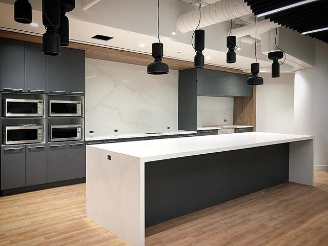 New staff lunch room looking good with #caesarstone 's Calacatta Nuvo quartz counters and backsplash. . . .  #countertop #kitchen #kitchencountertop #vanity #washroom #bathroom #commercial #residential #bars #fireplace #fireplacesurround #tubdeck #marble #granite #quartz #quartzite #design #interiordesign #cabinet #home #luxury @caesarstoneca @caesarstoneus