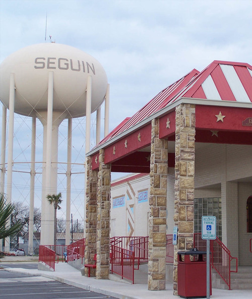 image of the Main Building in front of the Seguin Watertower