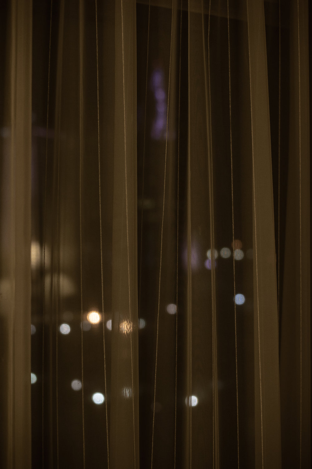holiday inn city lights through curtain.jpg