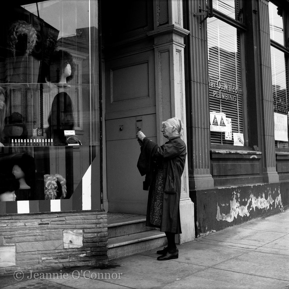 Imogen Cunningham taking a reading on Filmore Street, S.F.