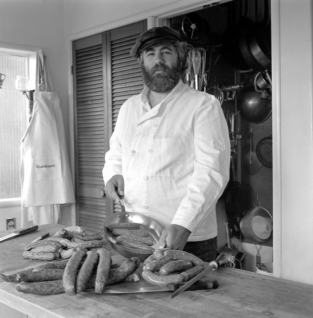 Bruce Aidells in kitchen making sausage
