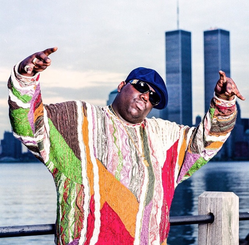 The Notorious B.I.G. standing in front of the former World Trade Center buildings in Lower Manhattan from the Jersey City waterfront, early 1990s (Photo Chi Modu)