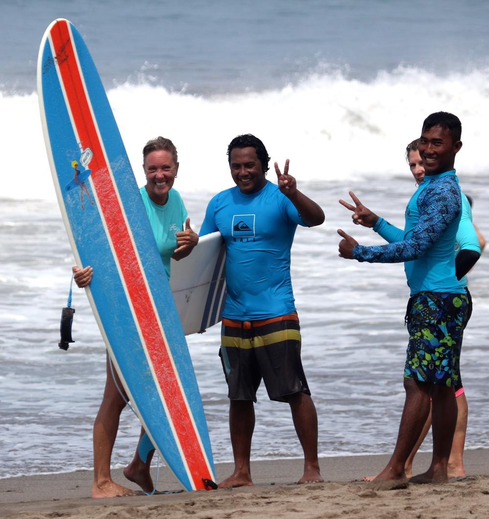 SHE surfs Bali