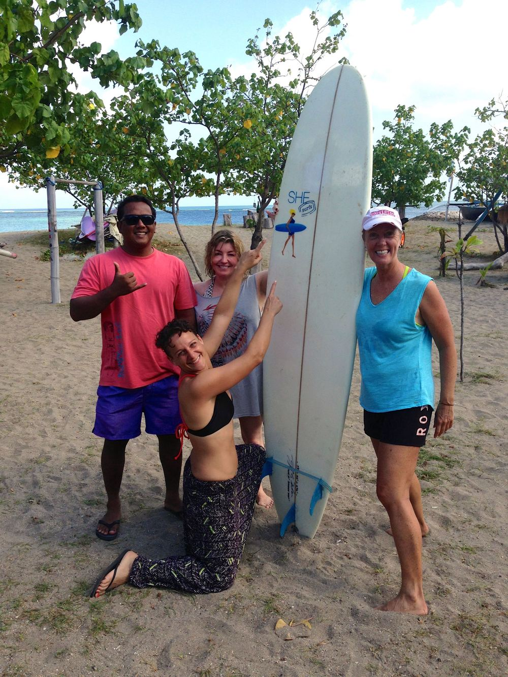 Celebrating after another awesome surf session on kuta reef with our little surfing family
