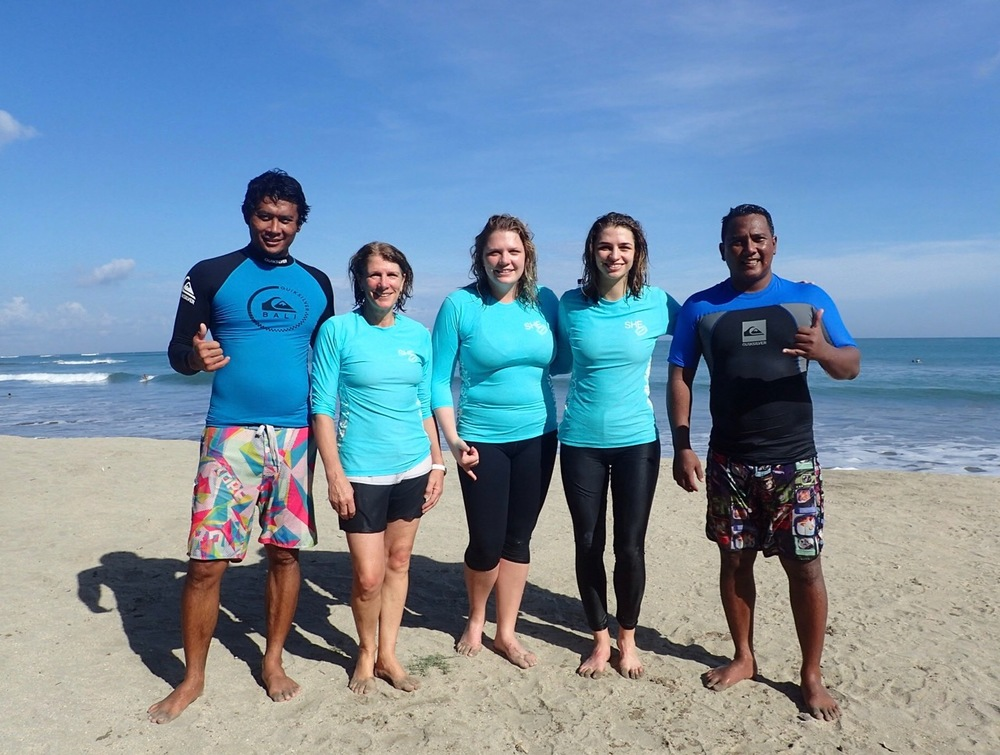 Sue, her daughters, and our surf guides Frengki & Putu