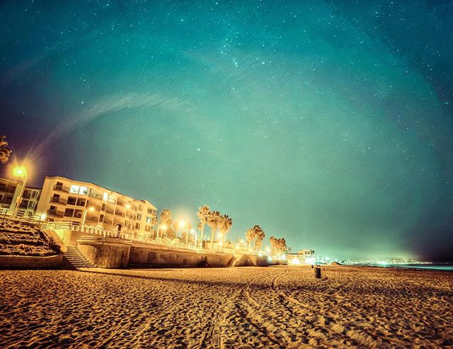 This is an #HDR image ... a combination of four images taken at different exposures (dark to light), and then combined digitally to expose the bright and dark parts of the shot in one photo. The super #wideangle #14mm lens did some weird things to the #light that really showed up in the digital composite. Kinda cool. #nightphotography #beach #stars #ocean #pacificocean #pacificbeach