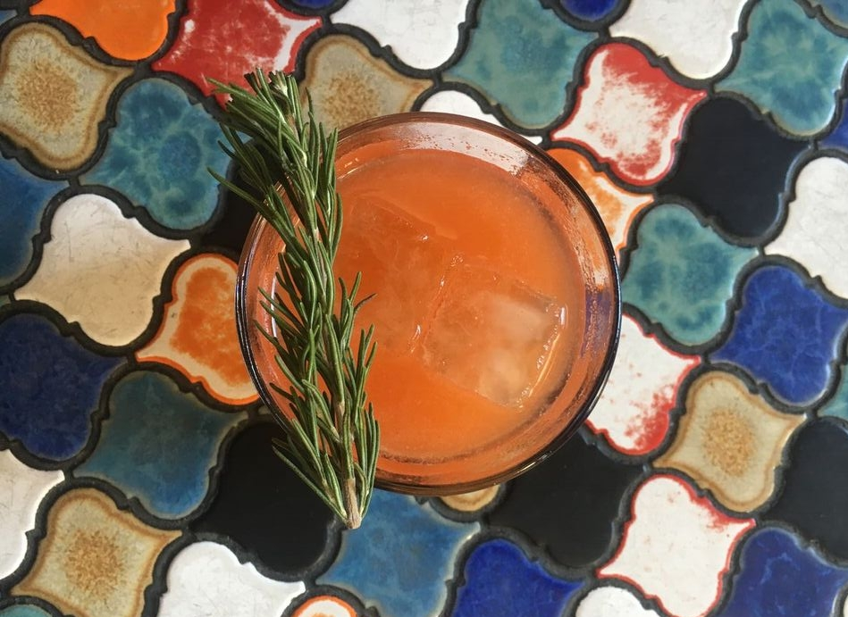 Farmer in the Bell is smoky, spicy and herbaceous. Made of red bell pepper, lime, Del Maguey Vida Mescal, Rosemary and Serrano tincture.