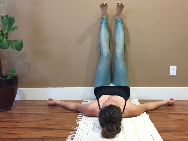 Legs up the wall, viparita karani.  I love this pose for its effect on circulation, knee health, and relaxation.