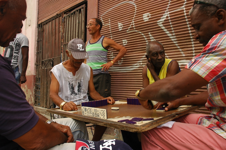 I saw multiple groups of guys playing dominoes on the street. It reminded me of how much I played the game as a kid.