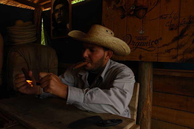 He is the son of the owner of the tobacco farm. He rolled that cigar right in front of us.