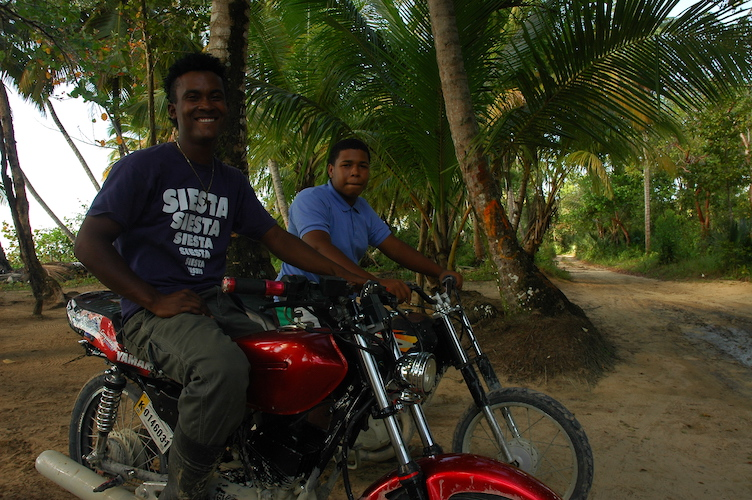 """Our """"taxi"""" drivers. No lie. Frances and I squished behind the first guy and Michaela sat behind the second guy as we rode 30 minutes to the isolated beach. They waited there for us so they didn't waste gas going back and forth."""