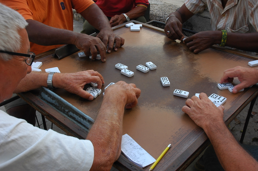 Guys playing dominoes in the street