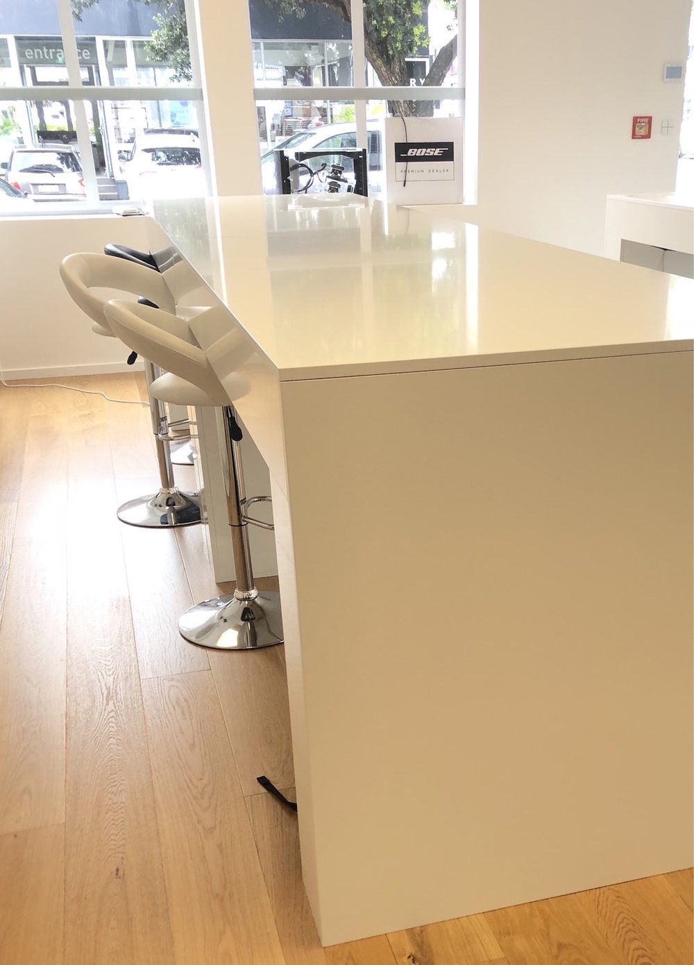 Island bench used as a desk within the Store's 'imitation' kitchen