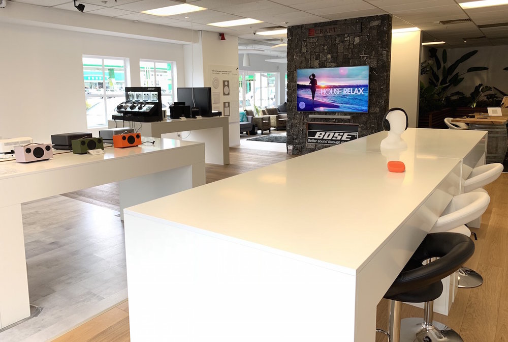 """The product display benches were made of MDF white satin. """"The outcome is exactly what we were after"""" - Chris, co-owner"""