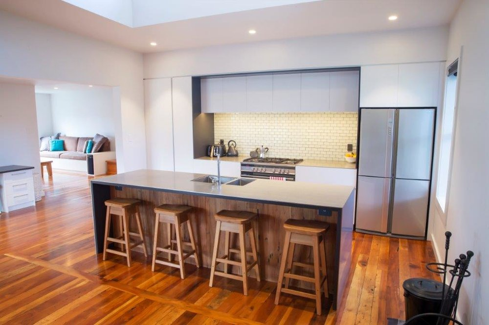 Open plan kitchen with flow to living spaces. Photo credit: Devin Hart