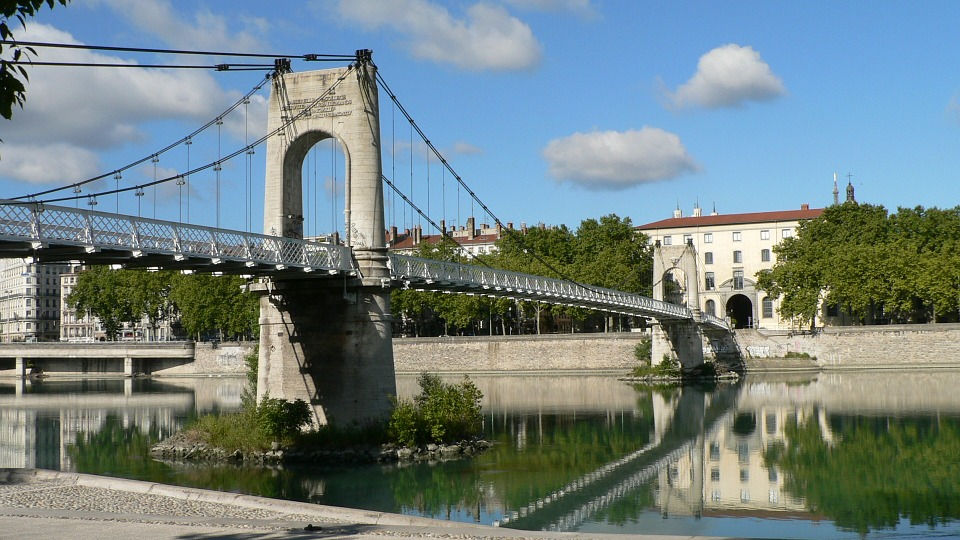 The Gateway College bridge crosses the river Rhone  in Lyon.