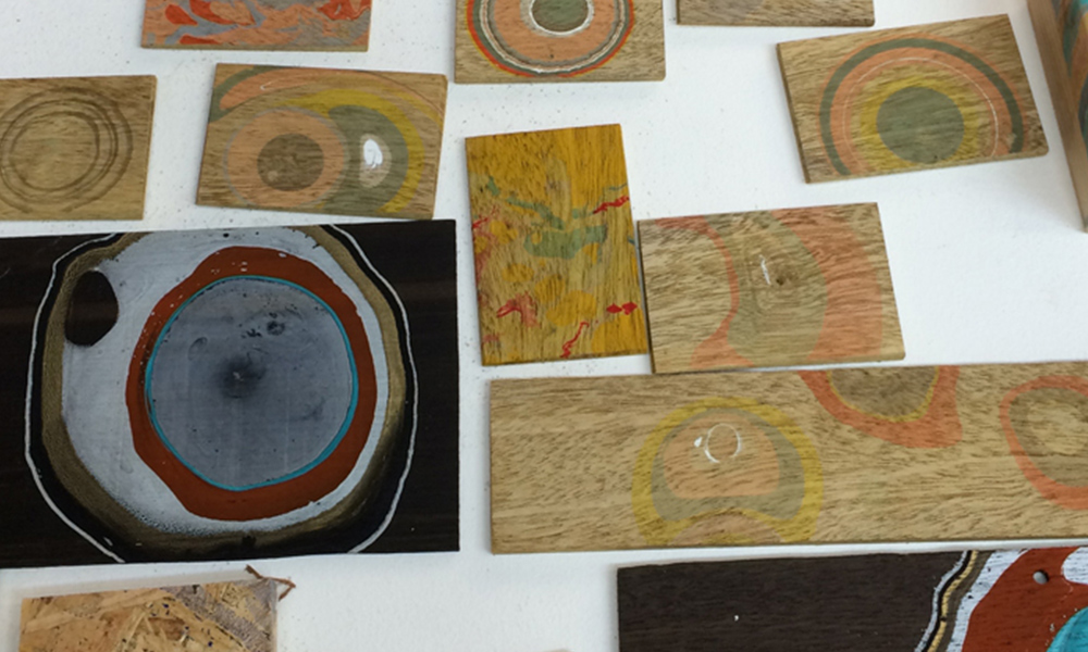 'These are some marbling tests on wood to see how the pigment would react.'