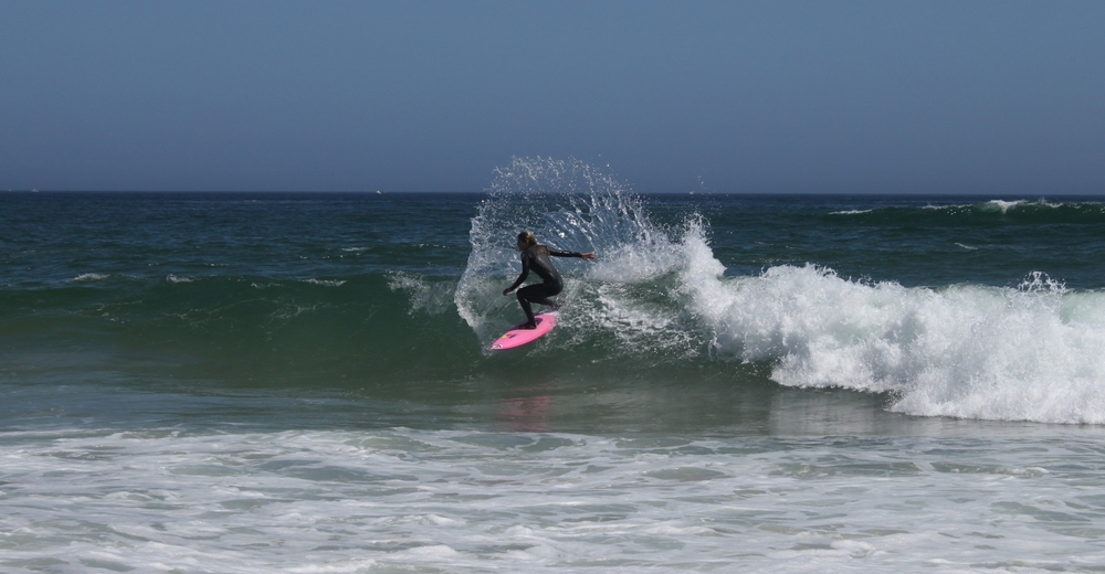Professional surfer, and Montauk native, Quincy Davis shredding the waves at Ditch Plains beach.