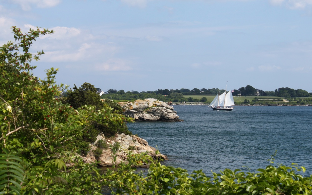 A schooner sails around Newport Neck past the southern tip of Jamestown, RI up into Narragansett Bay.