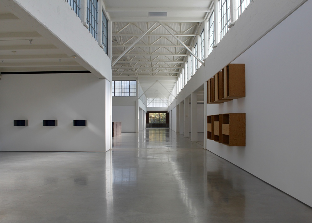 "Gazing east through the former Nabisco box printing factory, Dia:Beacon's spectacular museum space is lit almost entirely by natural light, categorizing it as a ""daylight museum."""