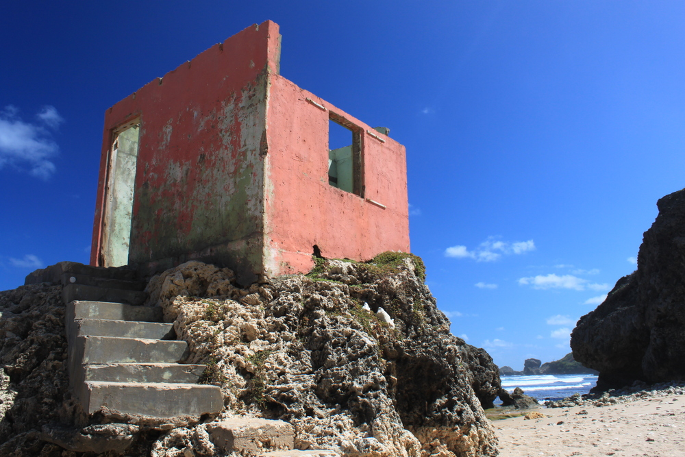 Ruins of a small pink building on the beach at Bathsheba, Barbados.