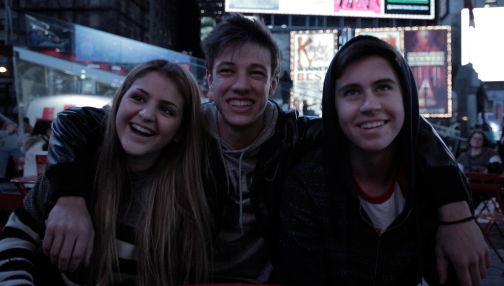 all three_arms around each other_times square2 USE.png