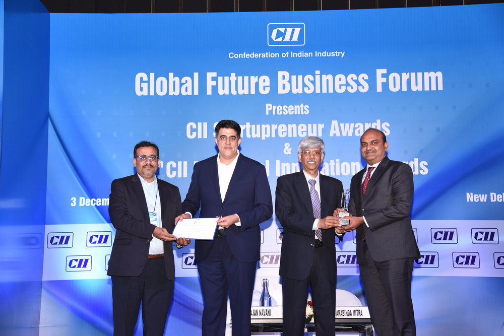 Prabhakar Munuswamy, Vice President, Application Development, and Satheesh Seetharaman, Assistant Vice President - Innovation received the Award