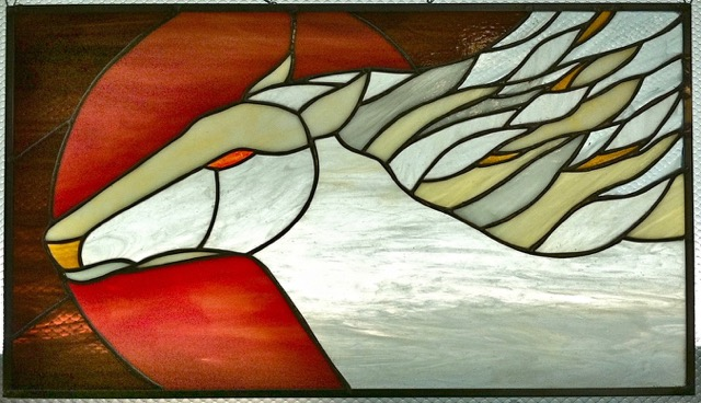 The Legend of White Horse Plain       Stained Glass Copper Foil     22 x 12.5 in.     2014