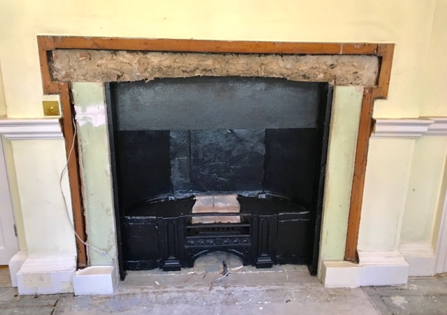 Fireplace discovery behind plasterboard