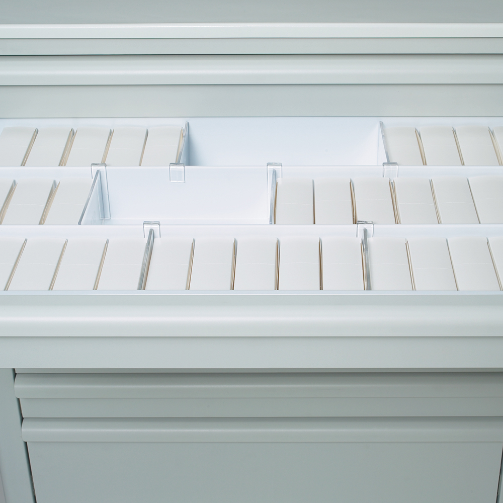Liner tray and dividers with unit dose boxes