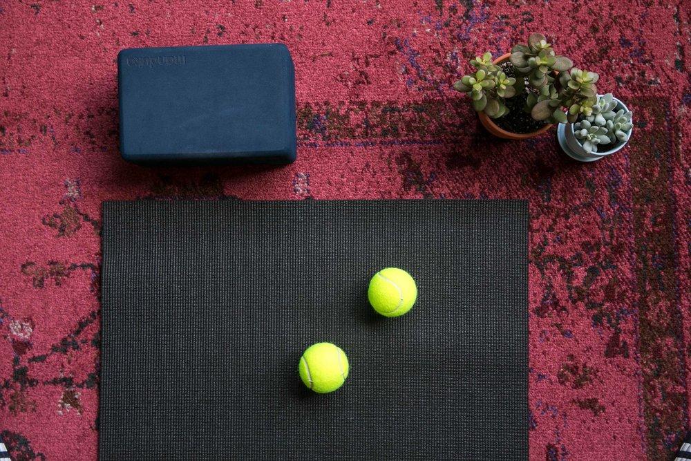 What you'll need: - -Two tennis balls-A yoga block-A mat