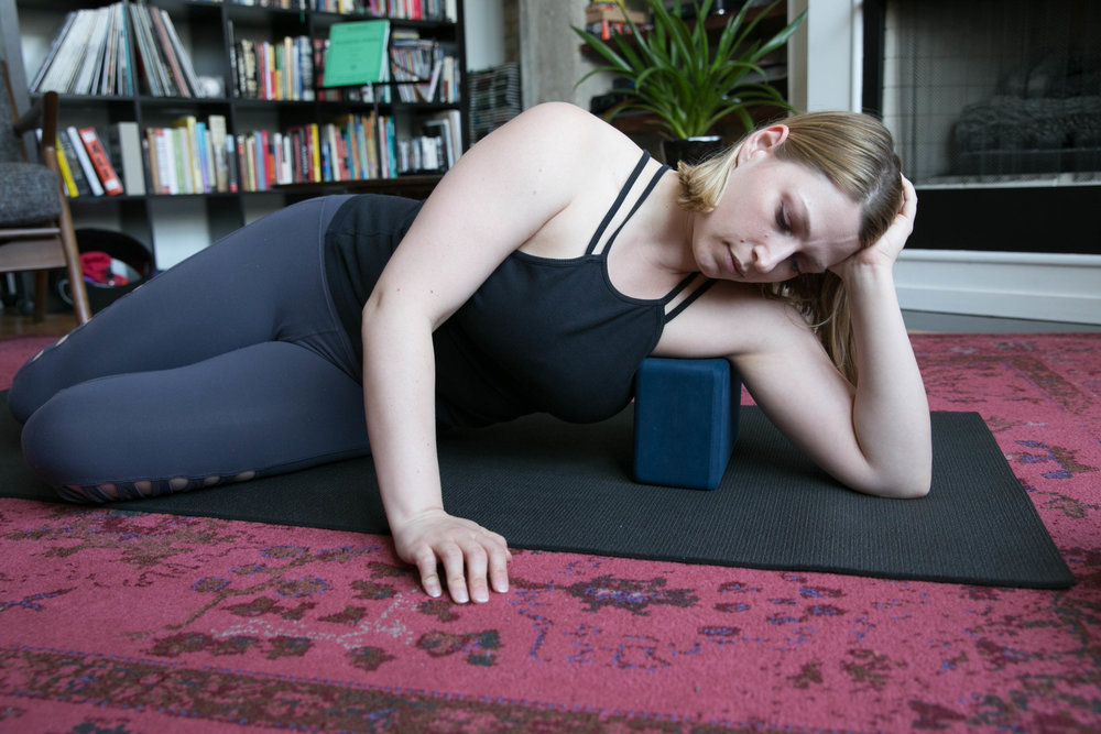 Setup: - Lay sideways with the block under your armpit. Use a towel on top if you need some cushion. Relax your head on your palm.