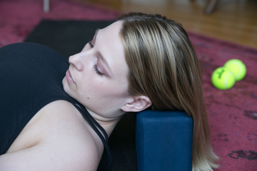 2. - Roll your head from right to left across the edge of the block, massaging your neck.Notice where your neck wants to grip, and stay in those spots a little longer to release them.