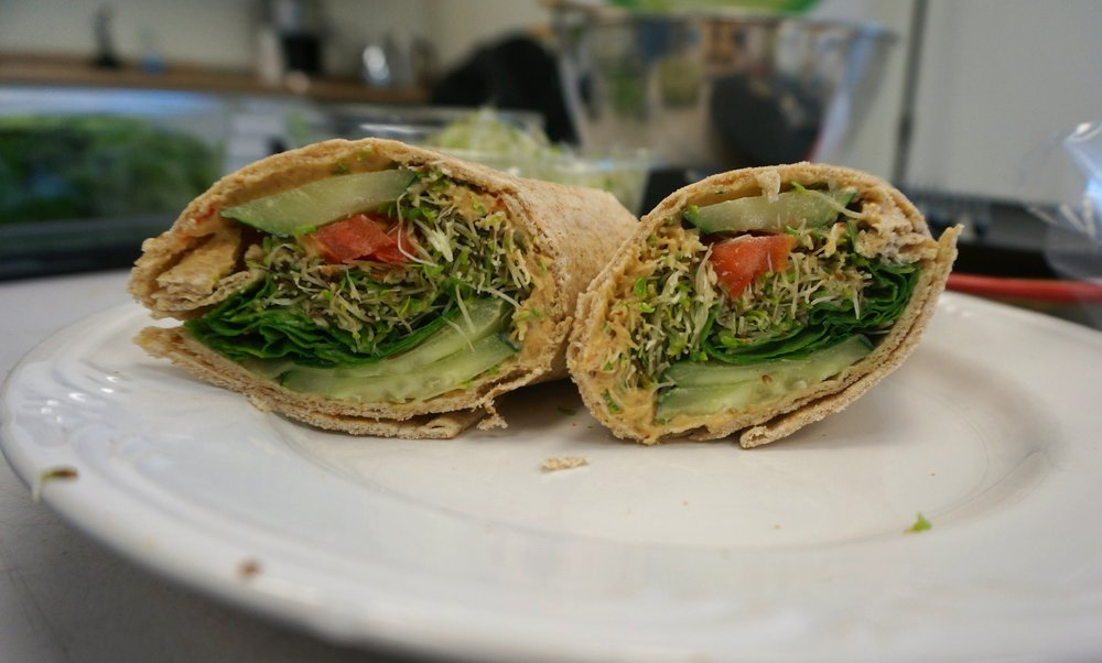 Garden Veggie Wrap - This Garden Veggie Wrap is super easy to make and filling! Smear some hummus on the wrap throw in some veggies and BAM! a delicious and healthy lunch!Recipe:Whole Wheat WrapVeggie HummusTomatoesSliced Cucumber A Handful of SpinachAlfalfa Sprouts